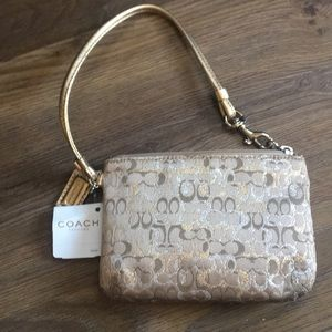 Coach Wristlet with flowery signature print